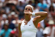 Sabine Lisicki of Germany celebrates after winning against Christina McHale of USA in her Women's Singles Second Round match during day four of the Wimbledon Lawn Tennis Championships at the All England Lawn Tennis and Croquet Club on July 2, 2015 in London, England.