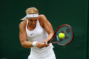 Sabine Lisicki of Germany plays a backhand during the Ladies Singles second round match agaist Samantha Stosur of Australia on day four of the Wimbledon Lawn Tennis Championships at the All England Lawn Tennis and Croquet Club on June 30, 2016 in London, England.