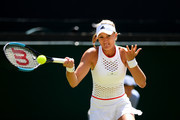 Kristina Mladenovic of France plays a forehand in her Ladies' Singles second round match against Petra Kvitova of The Czech Republic  during Day four of The Championships - Wimbledon 2019 at All England Lawn Tennis and Croquet Club on July 04, 2019 in London, England.