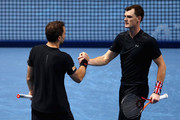 Jamie Murray of Great Britain and partner Bruno Soares of Brazil speak during the doubles match against Marcel Granollers of Spain and Ivan Dodig of Croatia on day four of the 2017 Nitto ATP World Tour Finals at O2 Arena on November 15, 2017 in London, England.