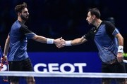 Croatia's Ivan Dodig (R) and Bosnia-Herzegovina's Marcel Granollers play against Britain's Jamie Murray and Brazil's Bruno Soares during their men's doubles round-robin match on day four of the ATP World Tour Finals tennis tournament at the O2 Arena in London on November 15, 2017..Murray and Soares won 6-1, 6-1. / AFP PHOTO / Glyn KIRK