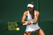 Vitalia Diatchenko of Russia plays a backhand in her Ladies's Singles first round match against Anna-Lena Friedsam of Germany during day one of the Wimbledon Lawn Tennis Championships at the All England Lawn Tennis and Croquet Club on June 29, 2015 in London, England.