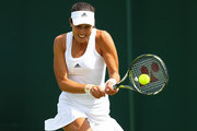 Ana Ivanovic of Serbia plays a backhand shot during the Ladies Singles first round match against Ekaterina Alexandrova of Russia on day one of the Wimbledon Lawn Tennis Championships at the All England Lawn Tennis and Croquet Club on June 27th, 2016 in London, England.