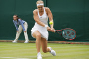 Sabine Lisicki of Germany plays a backhand shot during the Ladies Singles first round match against Shelby Rogers of The United States on day one of the Wimbledon Lawn Tennis Championships at the All England Lawn Tennis and Croquet Club on June 27th, 2016 in London, England.
