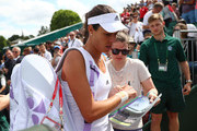 Ana Ivanovic of Serbia signs autographs following the Ladies Singles first round match against Ekaterina Alexandrova of Russia on day one of the Wimbledon Lawn Tennis Championships at the All England Lawn Tennis and Croquet Club on June 27th, 2016 in London, England.
