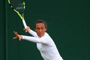Francesca Schiavone of Italy plays a forehand during the Ladies Singles first round match against Mandy Minella of Luxembourg on day one of the Wimbledon Lawn Tennis Championships at the All England Lawn Tennis and Croquet Club on July 3, 2017 in London, England.