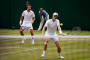 Jamie Murray of Great Britain and Bruno Soares of Brazil compete against Ken Skupski and Neal Skupski of Great Britain during their Men's Doubles third round match on day seven of the Wimbledon Lawn Tennis Championships at All England Lawn Tennis and Croquet Club on July 9, 2018 in London, England.