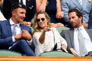 Sir Ben Ainslie (R) and his wife Georgie Thompson (C) attends day seven of the Wimbledon Lawn Tennis Championships at All England Lawn Tennis and Croquet Club on July 9, 2018 in London, England.