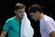 David Goffin of Belgium walks past Roger Federer of Switzerland in the semi finals during day seven of the Nitto ATP World Tour Finals tennis at the O2 Arena on November 18, 2017 in London, England.