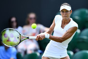 Vitalia Diatchenko of Russia returns a shot against Jelena Ostapenko of Latvia duirng their Ladies' Singles third round match on day six of the Wimbledon Lawn Tennis Championships at All England Lawn Tennis and Croquet Club on July 7, 2018 in London, England.