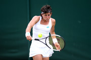 Carla Suarez Navarro of Spain plays a backhand in her Ladies' Singles third round match against Lauren Davis of The United States during Day six of The Championships - Wimbledon 2019 at All England Lawn Tennis and Croquet Club on July 06, 2019 in London, England.