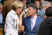 Lord Sebastian Coe and his wife Carole Annett make their way to their seats in the Royal Box during Day six of The Championships - Wimbledon 2019 at All England Lawn Tennis and Croquet Club on July 06, 2019 in London, England.