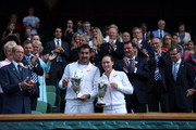 Samantha Stosur of Australia and Nenad Zimonjic of Serbia celebrate with the trophy after winning the Mixed Doubles final against Max Mirnyi of Belarus and Hao-Ching Chun of Chinese Taipei on day thirteen of the Wimbledon Lawn Tennis Championships at the All England Lawn Tennis and Croquet Club on July 6, 2014 in London, England.