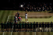 Novak Djokovic of Serbia lifts the trophy after winning Men's Singles final against Kevin Anderson of South Africa on day thirteen of the Wimbledon Lawn Tennis Championships at All England Lawn Tennis and Croquet Club on July 15, 2018 in London, England.