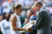 Prince Edward, Duke of Kent presents Angelique Kerber of Germany with the Venus Rosewater Dish after the Ladies' Singles final between Angelique Kerber of Germany  and Serena Williams of The United States on day twelve of the Wimbledon Lawn Tennis Championships at All England Lawn Tennis and Croquet Club on July 14, 2018 in London, England.