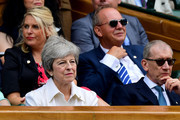 British Prime Minister Theresa May attend the Royal Box during Day twelve of The Championships - Wimbledon 2019 at All England Lawn Tennis and Croquet Club on July 13, 2019 in London, England.