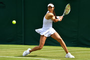 Vitalia Diatchenko of Russia plays a backhand in her Ladies' Singles first round match against Kristina Mladenovic of France during Day two of The Championships - Wimbledon 2019 at All England Lawn Tennis and Croquet Club on July 02, 2019 in London, England.