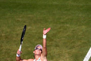 Samantha Stosur of Australia serves in her Ladies' Singles first round match against Carla Suarez Navarro of Spain during Day two of The Championships - Wimbledon 2019 at All England Lawn Tennis and Croquet Club on July 02, 2019 in London, England.
