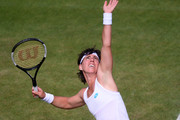 Carla Suarez Navarro of Spain serves in her Ladies' Singles first round match against Samantha Stosur of Australia during Day two of The Championships - Wimbledon 2019 at All England Lawn Tennis and Croquet Club on July 02, 2019 in London, England.