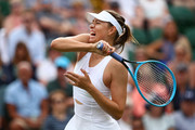 Maria Sharapova of Russia plays a shot in her Ladies' Singles first round match against Pauline Parmentier of France during Day two of The Championships - Wimbledon 2019 at All England Lawn Tennis and Croquet Club on July 02, 2019 in London, England.
