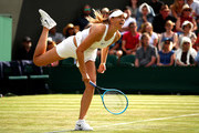 Maria Sharapova of Russia serves in her Ladies' Singles first round match against Pauline Parmentier of France during Day two of The Championships - Wimbledon 2019 at All England Lawn Tennis and Croquet Club on July 02, 2019 in London, England.