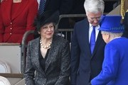 British Prime Minister Theresa May (L) and British Defence Secretary Michael Fallon (2nd R) greet Britain's Queen Elizabeth II ahead of a Service of Commemoration and Drumhead Service on Horse Guards Parade in central London on March 9, 2017, which honours the service and duty of both the UK Armed Forces and civilians in the Gulf region, Iraq and Afghanistan, and those who supported them back home, from 1990-2015..After the Drumhead Service, The Queen will officially unveil The Iraq and Afghanistan memorial. / AFP PHOTO / Justin TALLIS