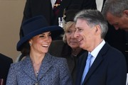 Britain's Catherine, Duchess of Cambridge (L) smiles a she talks to British Chancellor of the Exchequer, Philip Hammond (R) as they attend a Service of Commemoration and Drumhead Service on Horse Guards Parade in central London on March 9, 2017, which honours the service and duty of both the UK Armed Forces and civilians in the Gulf region, Iraq and Afghanistan, and those who supported them back home, from 1990-2015..After the Drumhead Service, The Queen will officially unveil The Iraq and Afghanistan memorial. / AFP PHOTO / Justin TALLIS