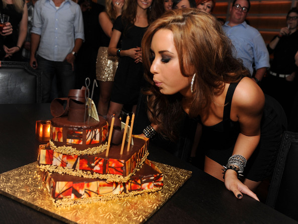 Demi Lovato (EXCLUSIVE ACCESS - PREMIUM RATES APPLY) Demi Lovato with birthday cake at Demi Lovato's 18th birthday party at Buddakan on August 19, 2010 in New York City.
