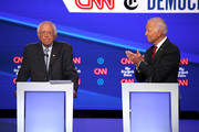 Sen. Bernie Sanders (I-VT) and former Vice President Joe Biden react on stage during the Democratic Presidential Debate at Otterbein University on October 15, 2019 in Westerville, Ohio. A record 12 presidential hopefuls are participating in the debate hosted by CNN and The New York Times.