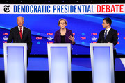 Sen. Elizabeth Warren (D-MA) (C) speaks as former Vice President Joe Biden and South Bend, Indiana Mayor Pete Buttigieg look on during the Democratic Presidential Debate at Otterbein University on October 15, 2019 in Westerville, Ohio. A record 12 presidential hopefuls are participating in the debate hosted by CNN and The New York Times.