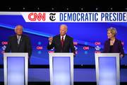 Former Vice President Joe Biden speaks as Sen. Bernie Sanders (I-VT) and Sen. Elizabeth Warren (D-MA) look on during the Democratic Presidential Debate at Otterbein University on October 15, 2019 in Westerville, Ohio. A record 12 presidential hopefuls are participating in the debate hosted by CNN and The New York Times.