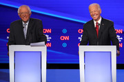 Sen. Bernie Sanders (I-VT) and former Vice President Joe Biden smile on stage during the Democratic Presidential Debate at Otterbein University on October 15, 2019 in Westerville, Ohio. A record 12 presidential hopefuls are participating in the debate hosted by CNN and The New York Times.