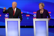 Former Vice President Joe Biden and Sen. Elizabeth Warren (D-MA) react during the Democratic Presidential Debate at Otterbein University on October 15, 2019 in Westerville, Ohio. A record 12 presidential hopefuls are participating in the debate hosted by CNN and The New York Times.