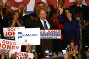 Democratic U.S. Senator elect Doug Jones (L) and wife Louise Jones (R) greet supporters during his election night gathering the Sheraton Hotel on December 12, 2017 in Birmingham, Alabama.  Doug Jones defeated his republican challenger Roy Moore to claim Alabama's U.S. Senate seat that was vacated by attorney general Jeff Sessions.