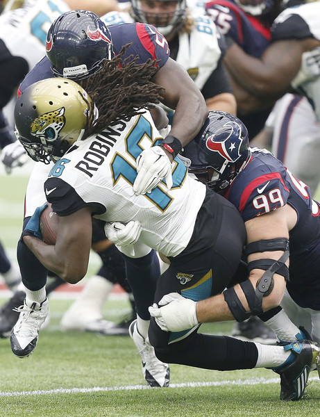 Jacksonville Jaguars v Houston Texans [watt 99,sports gear,sports,helmet,football gear,tackle,american football,canadian football,football helmet,gridiron football,football equipment,denard robinson,j.j.,whitney mercilus,houston,texas,nrg stadium,jacksonville jaguars,houston texans,loss]