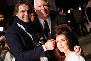 Designer Dennis Basso and Carol Alt prepare backstage for the Dennis Basso show during New York Fashion Week: The Shows at Cipriani 42nd Street on February 11, 2019 in New York City.