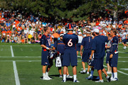 Quarterbacks Peyton Manning #18, Brock Osweiler #6 and Caleb Hanie #16 of the Denver Broncos talk during training camp at the Paul D. Bowlen Memorial Broncos Centre at Dove Valley on July 26, 2012 in Englewood, Colorado.
