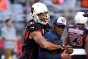 Wide receiver Larry Fitzgerald #11 of the Arizona Cardinals hugs head coach Vance Joseph of the Denver Broncos before the game at State Farm Stadium on October 18, 2018 in Glendale, Arizona.