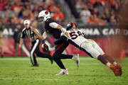 Linebacker Von Miller #58 of the Denver Broncos knocks the ball away from quarterback Josh Rosen #3 of the Arizona Cardinals during the third quarter at State Farm Stadium on October 18, 2018 in Glendale, Arizona. The fumble was overturned after a video replay.
