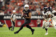 Wide receiver Larry Fitzgerald #11 of the Arizona Cardinals runs past cornerback Chris Harris #25 of the Denver Broncos during the third quarter at State Farm Stadium on October 18, 2018 in Glendale, Arizona.