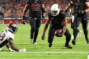 Wide receiver Larry Fitzgerald #11 of the Arizona Cardinals scores a four yard touchdown over defensive back Shamarko Thomas #38 of the Denver Broncos during the third quarter at State Farm Stadium on October 18, 2018 in Glendale, Arizona.