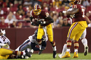Running back Adrian Peterson #26 of the Washington Redskins rushes past linebacker Von Miller #58 of the Denver Broncos in the first quarter during a preseason game at FedExField on August 24, 2018 in Landover, Maryland.