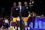 Rajon Rondo #9, LeBron James #23, Josh Hart #3 and head coach Luke Walton of the Los Angeles Lakers react to play from the sidelines during a preseason game against the Denver Nuggets at Staples Center on October 2, 2018 in Los Angeles, California.