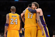 (R-L) Pau Gasol #16 hugs teammate Andrew Bynum #17 of the Los Angeles Lakers in the fourth quarter alongside Kobe Bryant #24 while taking on the Denver Nuggets in Game Seven of the Western Conference Quarterfinals in the 2012 NBA Playoffs on May 12, 2012 at Staples Center in Los Angeles, California. NOTE TO USER: User expressly acknowledges and agrees that, by downloading and or using this photograph, User is consenting to the terms and conditions of the Getty Images License Agreement.