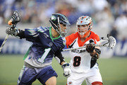 Joe Walters #1 of the Chesapeake Bayhawks runs with the ball with pressure from Gregory Downing #8 of the Denver Outlaws during a MLL lacrosse game at Navy-Marine Corps Memorial Stadium on June 6, 2015 in Annapolis, Maryland.