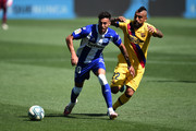 Victor Camarasa of Deportivo Alaves competes for the ball with Arturo Vidal of FC Barcelona during the Liga match between Deportivo Alaves and FC Barcelona at Estadio de Mendizorroza on July 19, 2020 in Vitoria-Gasteiz, Spain. Football Stadiums around Europe remain empty due to the Coronavirus Pandemic as Government social distancing laws prohibit fans inside venues resulting in all fixtures being played behind closed doors.