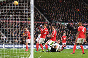 Nicklas Bendtner of Nottingham Forest scores an own goal for Derby County's first during the Sky Bet Championship match between Derby County and Nottingham Forest at iPro Stadium on December 11, 2016 in Derby, England.