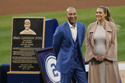 Former New York Yankees great, Derek Jeter and his wife Hannah pose in front of his plaque during a pregame ceremony honoring Jeter and retiring his number 2 at Yankee Stadium on May 14, 2017 in New York City.