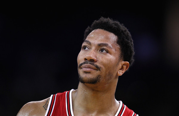 Chicago Bulls v Golden State Warriors [photograph,basketball player,chin,forehead,cheek,facial hair,player,muscle,photography,derrick rose,user,user,note,terms,chicago bulls,golden state warriors,court,game]
