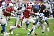 David Johnson #32 of the Arizona Cardinals runs with the ball while avoiding tackles by Christian Jones #52 and Quandre Diggs #28 of the Detroit Lions during the first quarter at State Farm Stadium on September 08, 2019 in Glendale, Arizona.